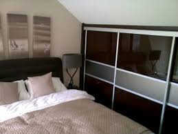 Sloped Ceiling Bedroom Decorating Ideas With Solid Wood Wardrobes And  Drawers