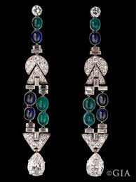 art deco chandelier earrings made with platinum emeralds sapphires and diamonds measures approximately 3 1 2 long