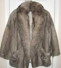 a consignment client brought me the fur coat pictured above to on i know nothing of furs so i had auction wally appraise it for me