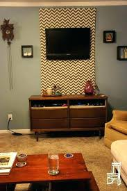hide wires behind on wall cables with a fabric panel mounted hiding flat screen above fireplace