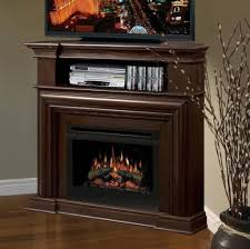 inspiring dark brown wooden corner tv stands with electric fireplace and center open compartment