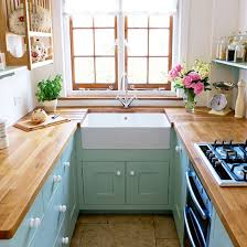 cabinets for small kitchens designs. small kitchen with white walls, green cabinets, butler sink and wood worktops cabinets for kitchens designs s