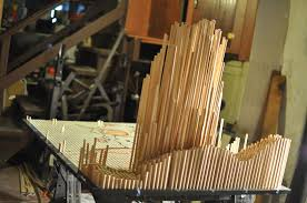 picture of placing the dowel rods into the board