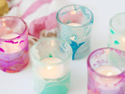 use nail polish to create marbled votives