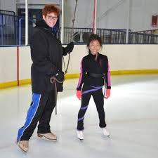 skating instructor with young girl