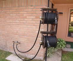 garden hose reel wall mount. Dual Swiveling Pole Mounted Garden Hose Reels Reel Wall Mount
