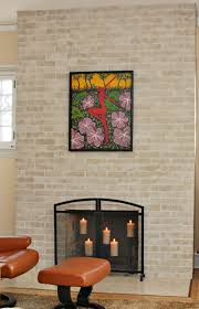 freshen a dated brick fireplace by painting the it light bright colors that complement the