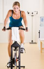 pedal away the pounds with stationary bike workouts