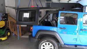 diy jeep hoist video shows how to use 4 straps and ratchet system to hoist a jeep wrangler hard top