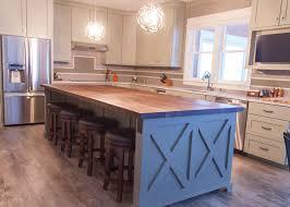 Farmhouse chic: sleek walnut butcher block countertop, barn wood kitchen  island, stainless steel
