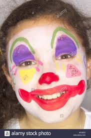Girl Clown Face Designs Young Girl With Happy Face Painted Like Clown Stock Photo