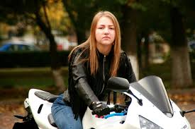 girl motorcycle leather jacket ride biker blonde