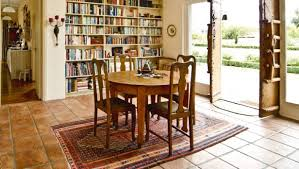 a patterned rug under a dining table is less likely to suffer obvious stains from food