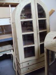 cabinet arched top 2 glass paned doors