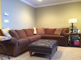 what do you recommend above this family room l shaped sectional couch both walls room is small tv is across from couch not enough room to pull couch