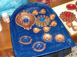lamps diya to begin with is divas the other name for diwali is deepawali or deepon ki aavali which means exhibition of lights