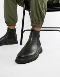 this versatile casual chelsea boot from dockers is an easy choice to pair with jeans or khakis for go to casual or weekend wear smooth man made