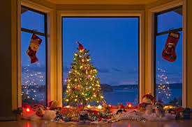 Photo of typical home decoration showing a tree and gifts during the weeks  leading up to Christmas day.