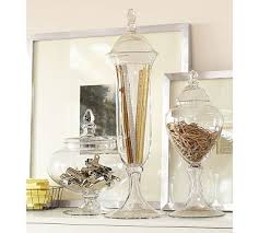 glass canisters single or tiered are perfect for the home office canisters keep items organized while making an interesting display of ordinary items