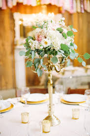 gold candelabra centerpiece with blush and ivory flowers from candle chandelier centerpieces weddings