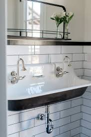 custom double bathroom with cast iron trough sink by rafterhouse of cast iron drop in bathtub