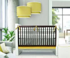 interactive uni baby room design ideas with rectangular dark brown baby bedding and big yellow drum lampshade in bedroom