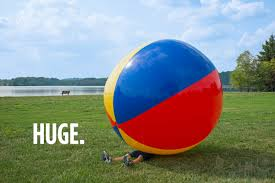 beach ball on beach. Man Underneath An Enormous 9-foot Beach Ball. Ball On L