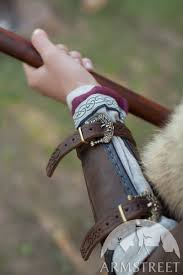 viking embossed leather bracers shieldmaiden available in brown leather black leather milk white leather by meval armstreet