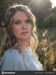 portrait beautiful woman makeup hairstyle wearing light blue dress summer stock photo