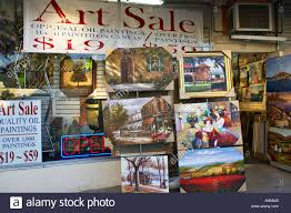 wisconsin lake geneva inexpensive oil paintings displayed outside downtown district