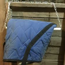 here it is in action with one of our heaviest blankets the stall door is off to the right you can see the shadow there is plenty of space for the
