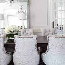 gray damask dining chairs with dark stained dining table
