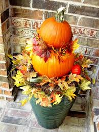 you can also place vibrant fall leaves in between the stacked pumpkins for instant fall outdoor decorations source