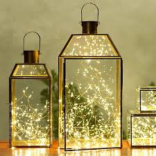 Reuse old glass lanterns and add a shimmering light installation