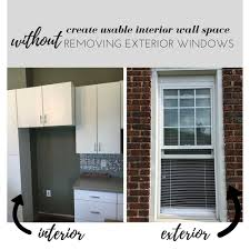 create usable interior wall space without removing exterior windows