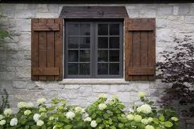 exterior house shutters. Rustic Exterior Idea With Stone Walls And Hand Made Window Shutters Header House E