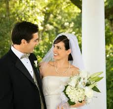 a bride and groom standing next to a white column ing columns for your wedding