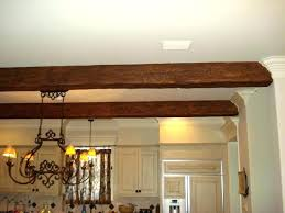faux wood paint kit kitchen beams blend beautifully with the existing house features faux wood crown faux wood paint