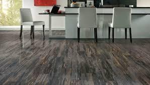 thunder wood luxury vinyl plank flooring base white kitchen island brown parson armless dining chair with grey faux leather seat black tile backsplash mugs