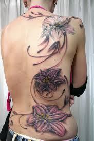 backpiece flower tattoo 55 awesome lily tattoo designs 3 3