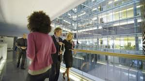 group contemporary office. Attractive Diverse Business Group Walking Through One Floor Of A Large Contemporary Office Building. In C