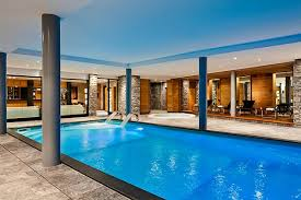 mansion with indoor pool with diving board. Extraordinary Blue Refreshing Large Swimming Pool Design Mansion With Indoor Diving Board N
