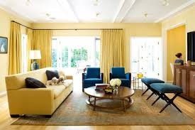 living room yellow living room with yellow curtain and carpet and table and lamp and
