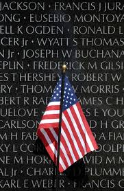 u s department of defense photo essay a small american flag stands against the vietnam veterans memorial during a ceremony to add the