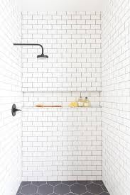 subway tiled shower ledge with black grout