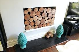 faux logs for fireplace place faux fireplace logs with tea lights