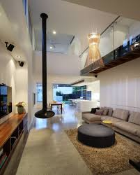 living room pendant lighting ideas. decorative pendant lights and fireplace for modern living room design ideas with high ceiling using round ottoman table beige sectional sofa set lighting
