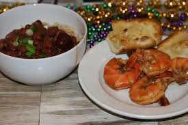 bbq cajun shrimp red beans and rice with garlic bread