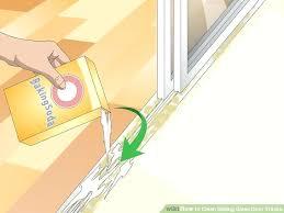 cleaning sliding door tracks image titled clean sliding glass door tracks step 8 grease sliding door