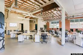a look inside the offices of connectivity which features beige walls and glimpses of exposed brick wood beams and the occasional mural calming colors for office